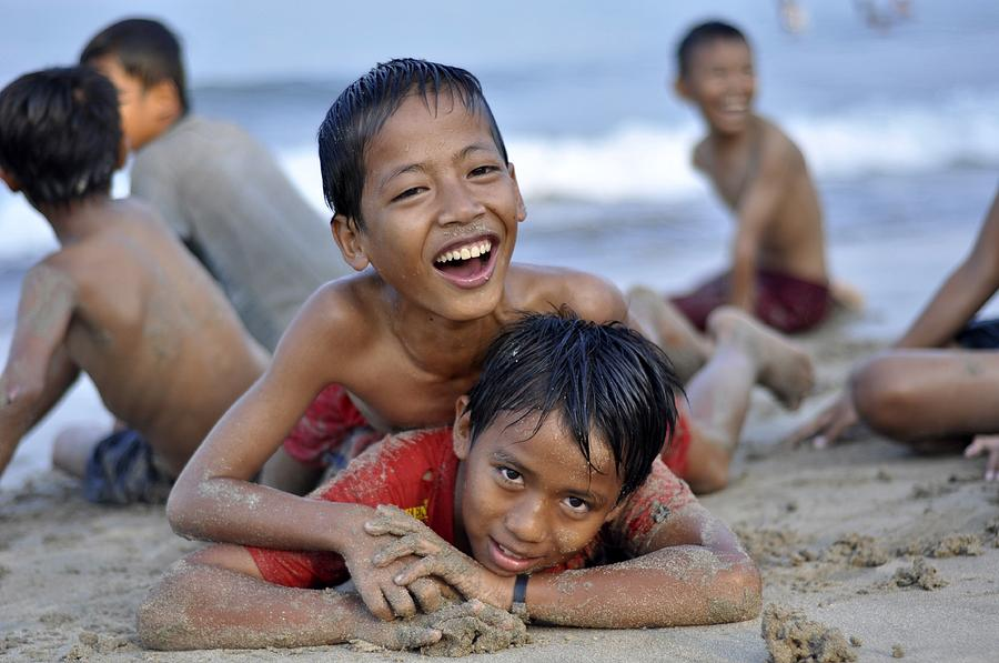 Children Photograph - Playing On The Beach by Achmad Bachtiar