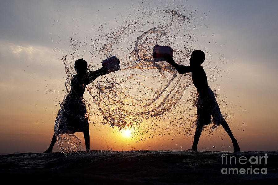 Indian Boys Photograph - Playing With Water by Tim Gainey