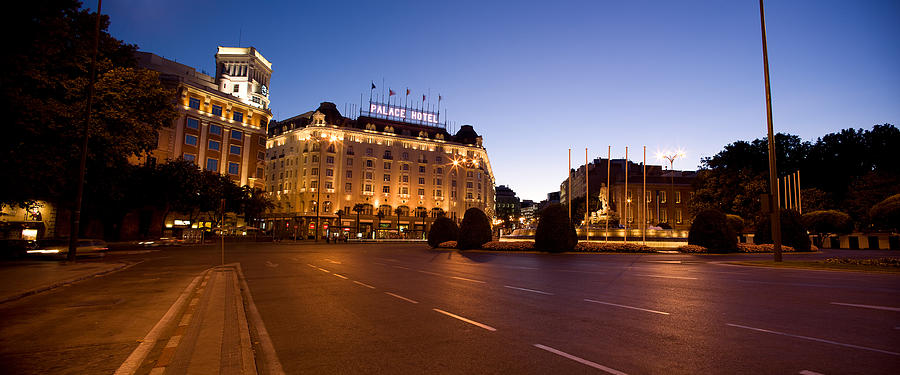 Color Image Photograph - Plaza De Neptuno And Palace Hotel by Panoramic Images