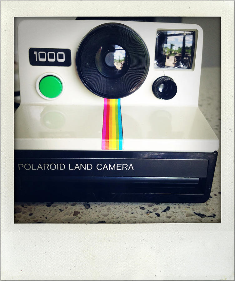 Aged Photograph - Polaroid camera.  by Les Cunliffe
