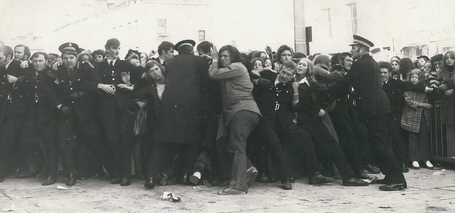 Retro Photograph - Police Hold Back Screaming Fans Trying To Get Tickets by Retro Images Archive