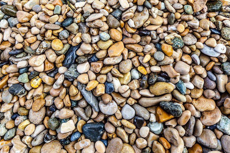 polished stones in a stream by Charles Lupica