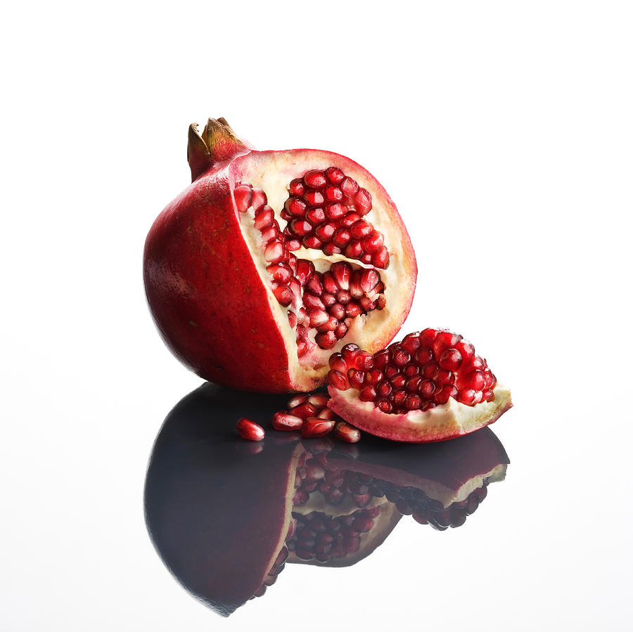 Pomegranate Photograph - Pomegranate Opened Up On Reflective Surface by Johan Swanepoel