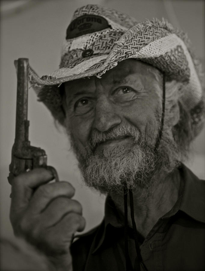 Streched Canvases Photographs Photograph - Portrait Of A Joyful Gunslinger . Viewed 244 Times  by  Andrzej Goszcz