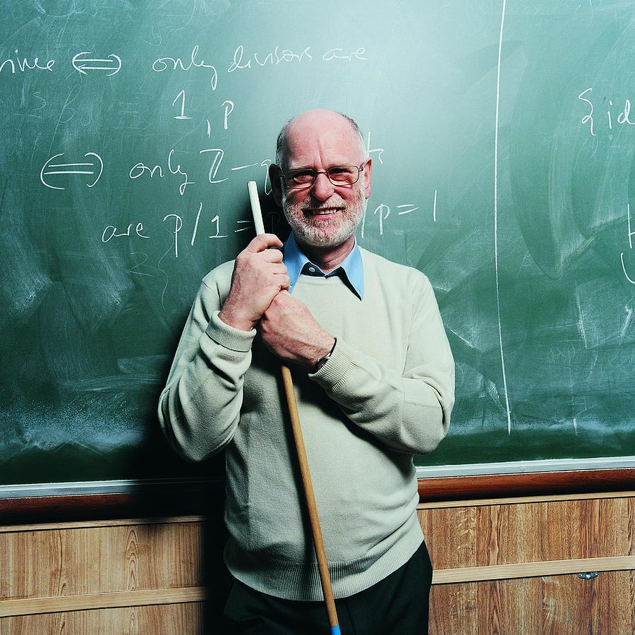 Portrait of a Maths Lecturer Photograph by Digital Vision.
