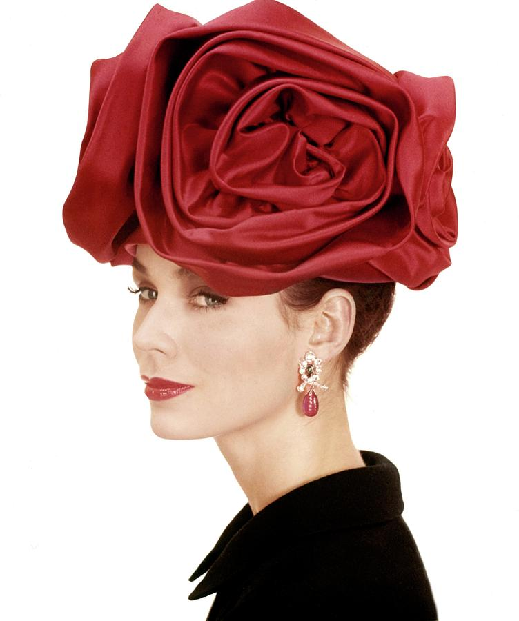 Portrait Of A Model Wearing A Hat Of Roses Photograph by Henry Clarke