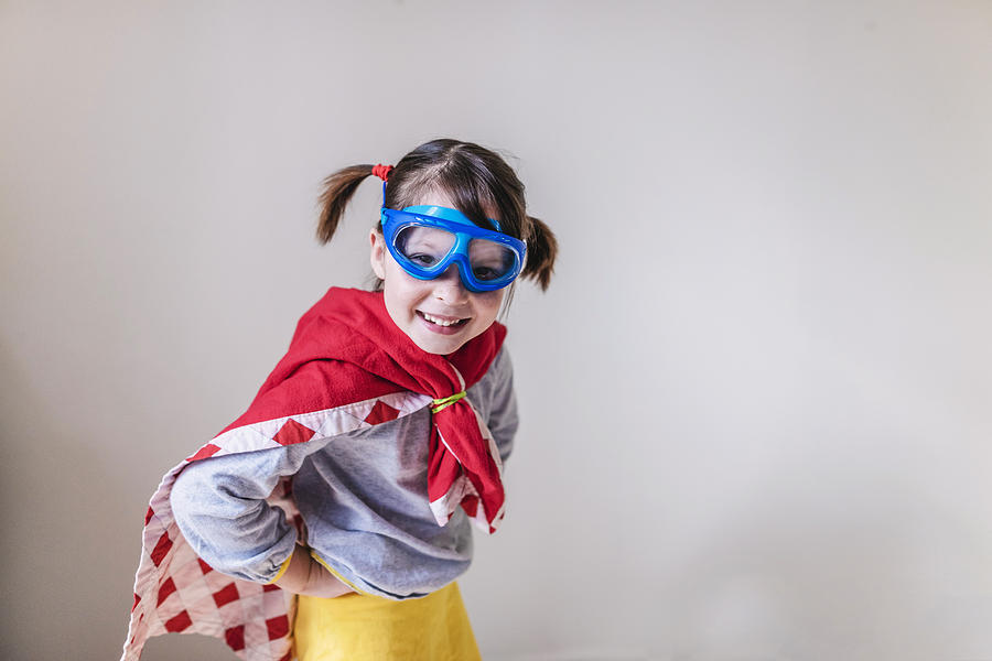 Portrait of a smiling girl dressed as a superhero Photograph by Elizabethsalleebauer