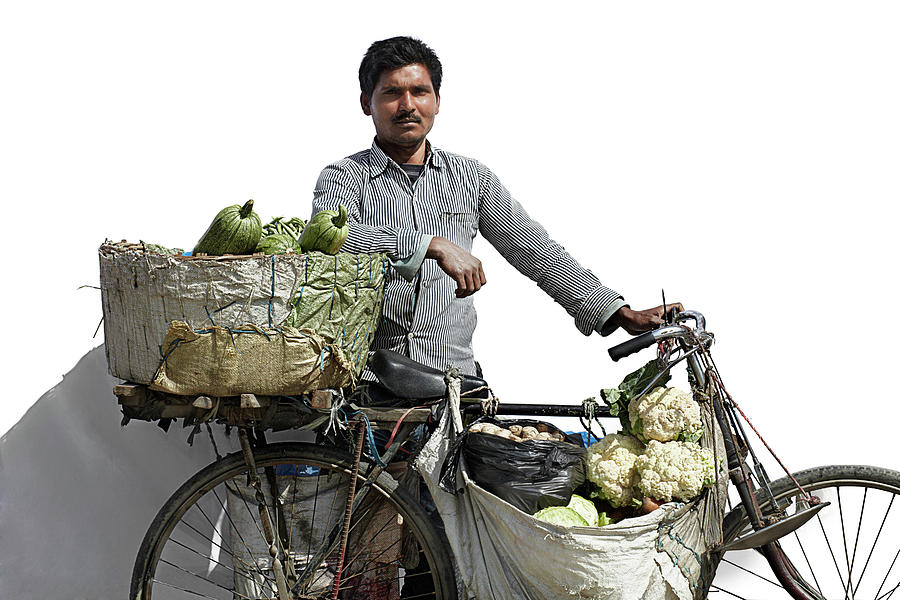Portrait Of A Vegetable Vendor In Photograph by Paper Boat Creative