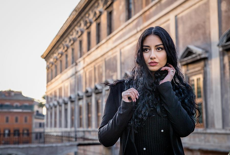 Portrait Of Beautiful Young Woman Standing Against Building Photograph by Kate Passileggeri / EyeEm