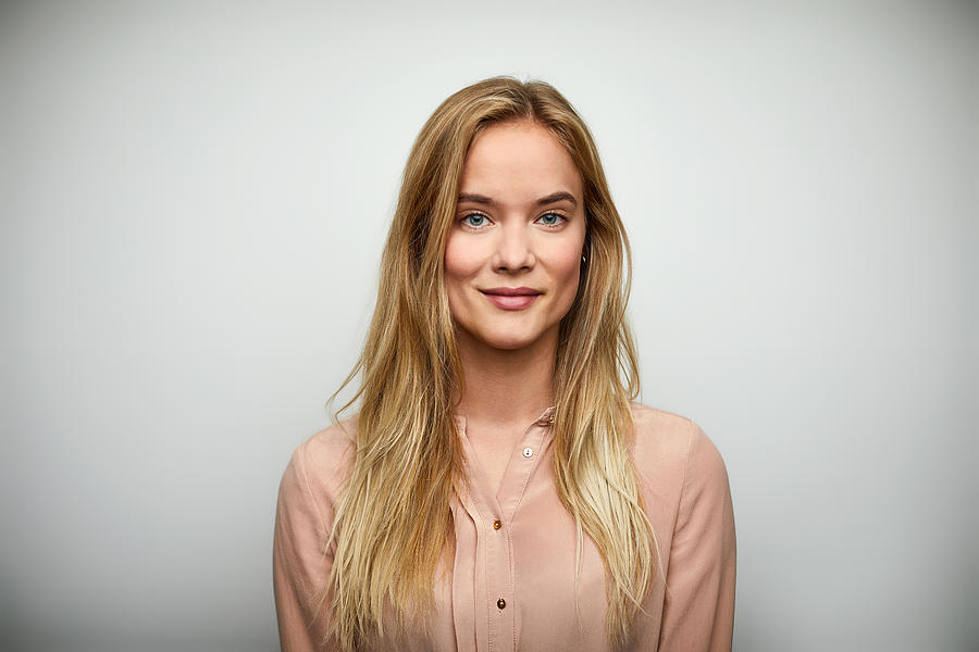 Portrait of businesswoman with long blond hair Photograph by Morsa Images