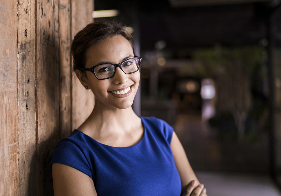 Portrait Of Confident Businesswoman Against Wooden Wall Photograph by Portra