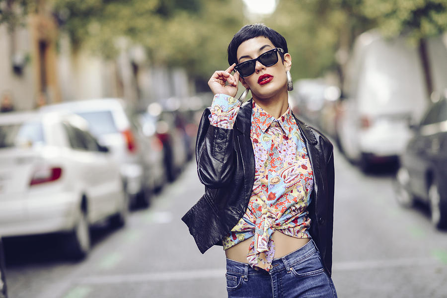 Portrait of fashionable young woman wearing sunglasses and leather jacket Photograph by Westend61