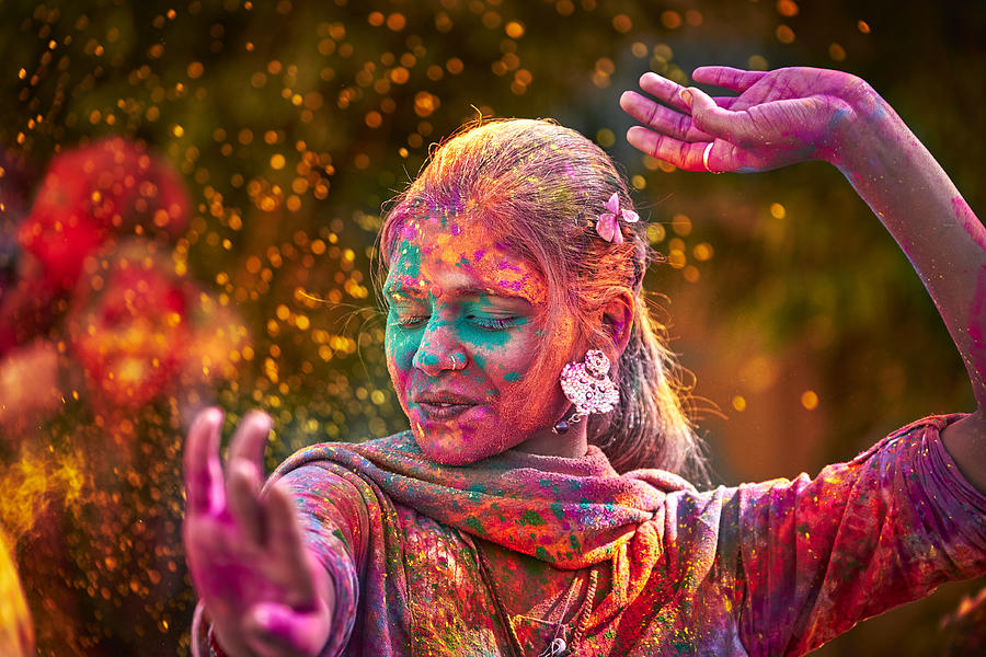 Portrait Of Indian Woman With Colored Face Dancing During Holi Photograph by Maodesign