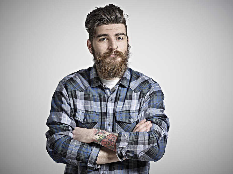Portrait of man with beard, tattoos & check shirt. Photograph by Mike Harrington
