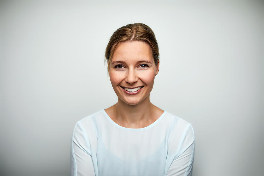 Portrait Of Mid Adult Businesswoman Smiling Photograph by Morsa Images