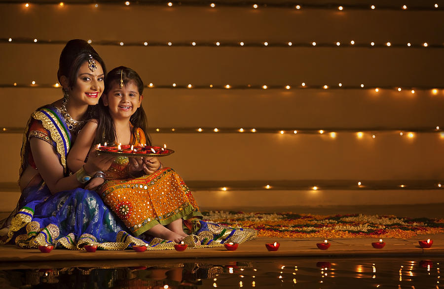 Portrait of mother and daughter with tray of diyas Photograph by Hemant Mehta