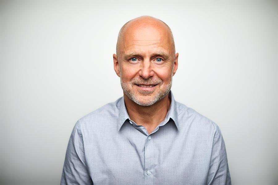 Portrait of senior businessman smiling Photograph by Morsa Images