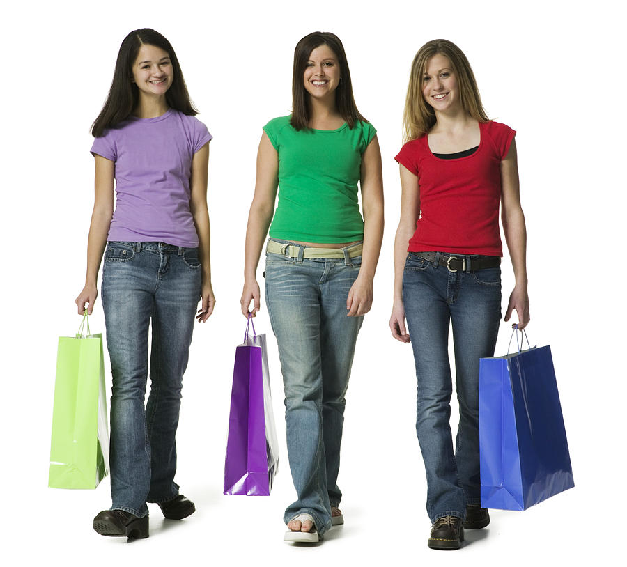 Portrait of teenage girls carrying shopping bags Photograph by Photodisc