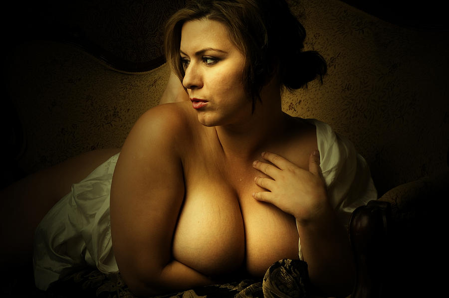 Portrait of Voluptuous Woman and Holding Her Cleavage Photograph by Bns124