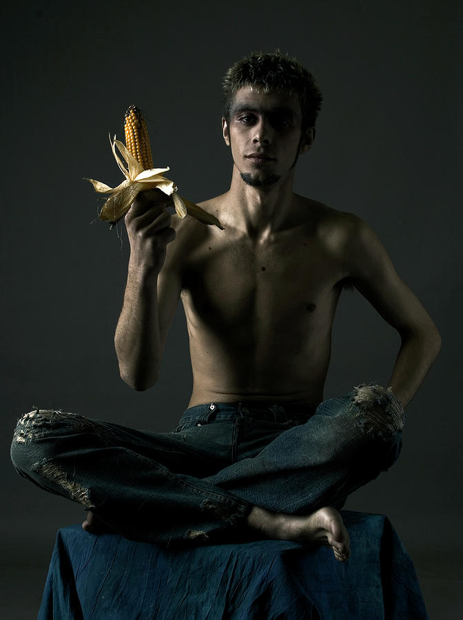 Portrait Photograph - Portrait Of Young Man With Corn Cob by Evgeniy Lankin