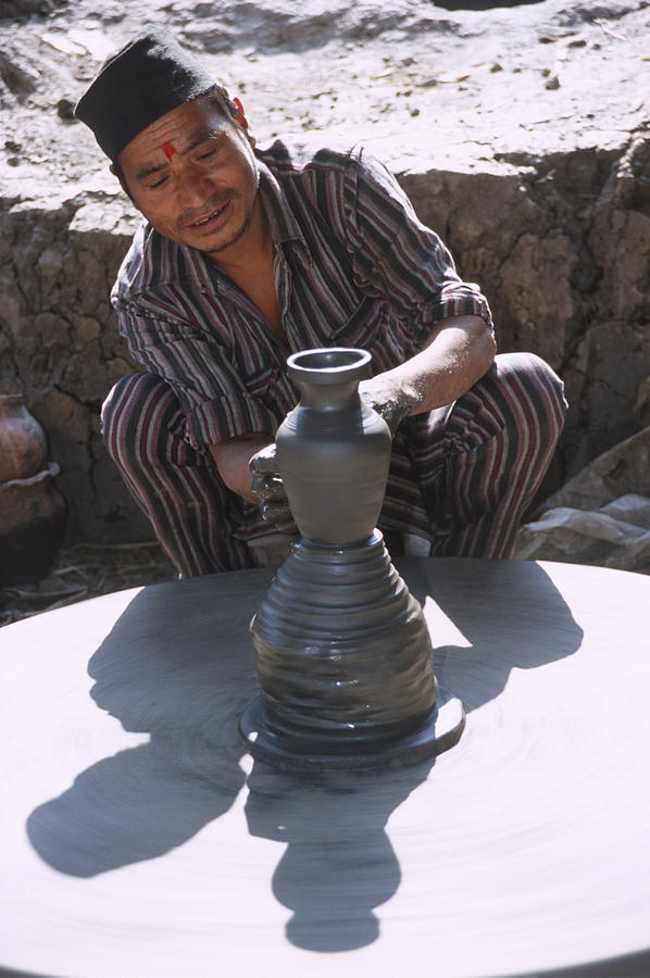 Nepal Photograph - Potter at work in Bhaktapur by Richard Berry