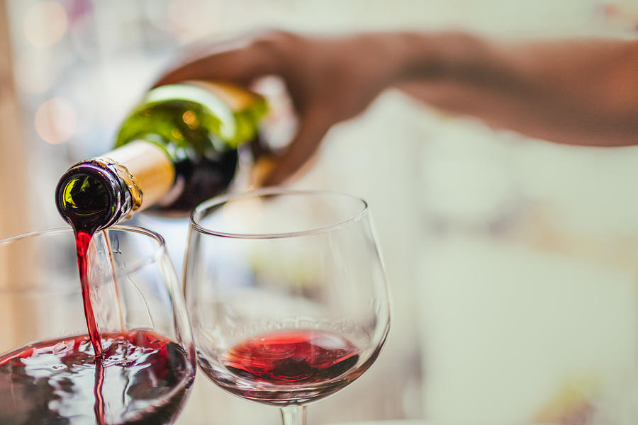 Pouring Red Wine In Glasses Photograph by Instants
