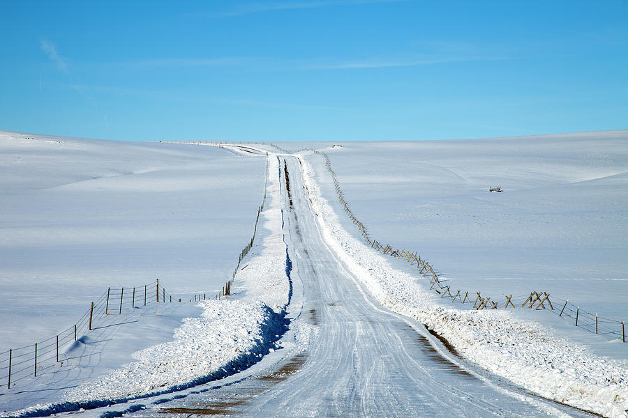 Pov Of Snow Covered Country Road Photograph by Andrew Geiger