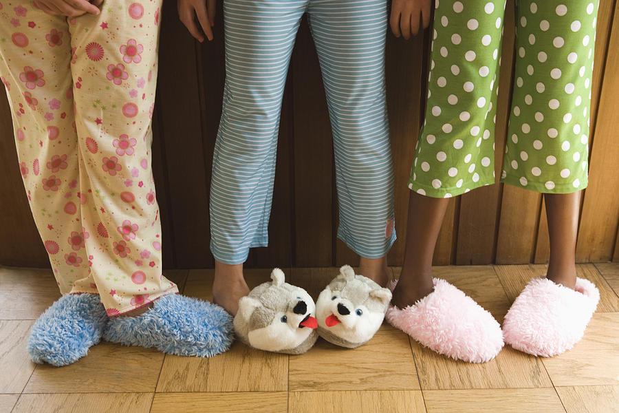 Pre-teen girls wearing fuzzy slippers Photograph by Reggie Casagrande