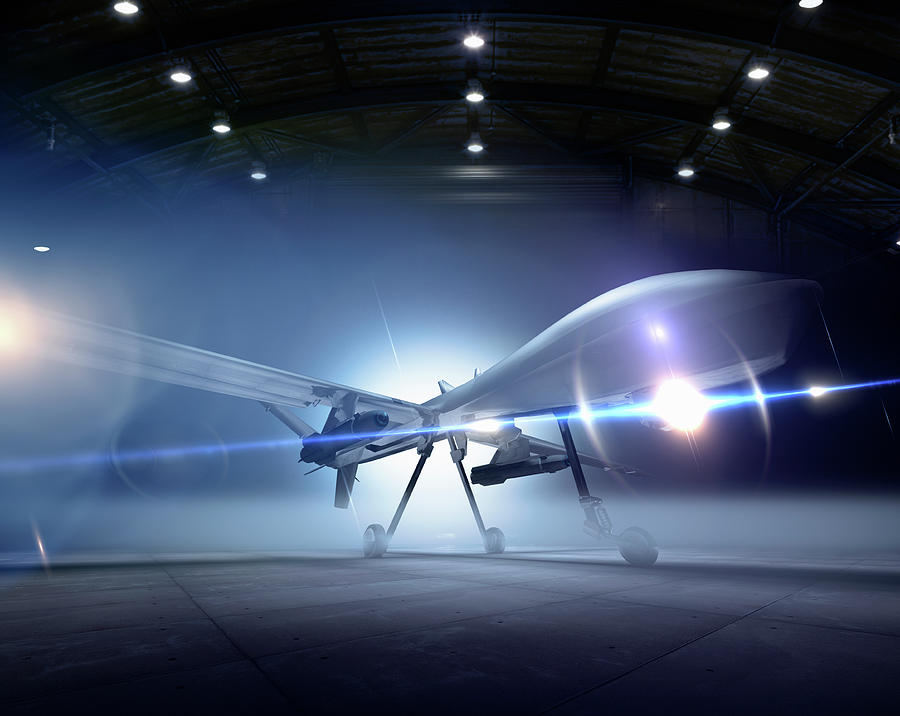 Predator Drone At The Ready In A Hangar Photograph by Colin Anderson