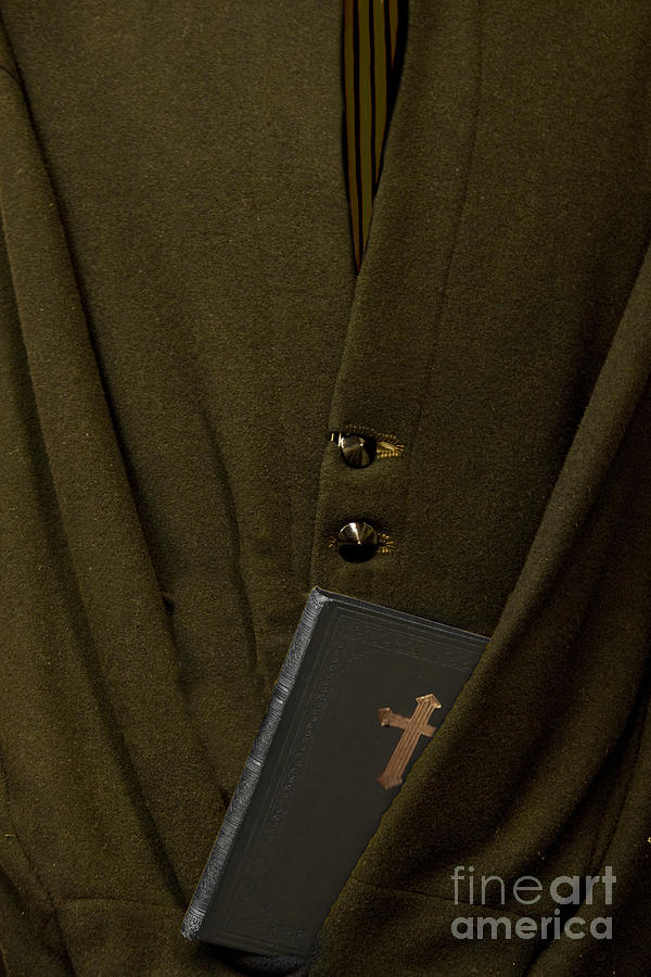 Mens; Old; Grunge; Bible; Binding; Side View; Cross; Metallic; Symbol; Religion; Book; Words; Symbolism; Close Up; Still Life; Object; Read; Prayer; Religious; Priest; Man; Dark; Darkness; Faith; God; Jesus; Clergy; Buttons; Jacket; Christian; Catholic; Photograph - Priest by Margie Hurwich
