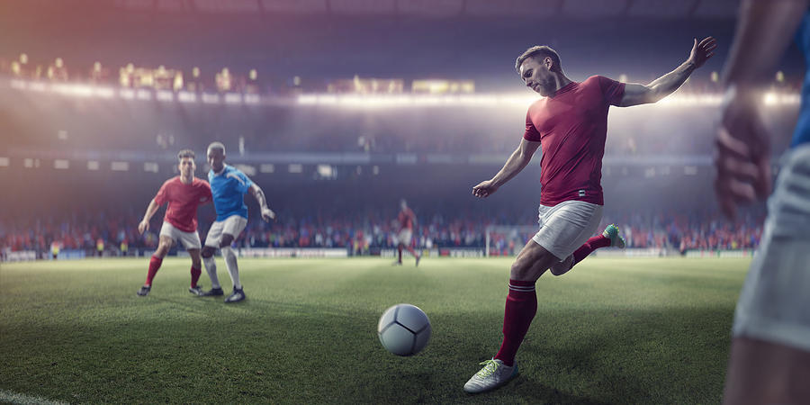 Professional Soccer Player About To Kick Football During Soccer Match Photograph by Peepo