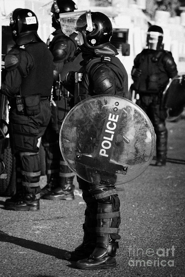 Northern Photograph - Psni Officer In Full Riot Gear With Shield On Crumlin Road At Ardoyne Shops Belfast 12th July by Joe Fox