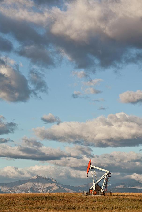 Pumpjack In Alberta Photograph by Imaginegolf