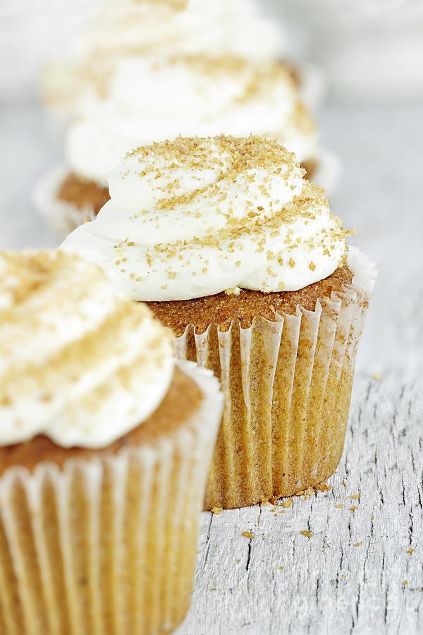 Pumpkin Photograph - Pumpkin Spice Cupcake With Cream Cheese Icing by Stephanie Frey