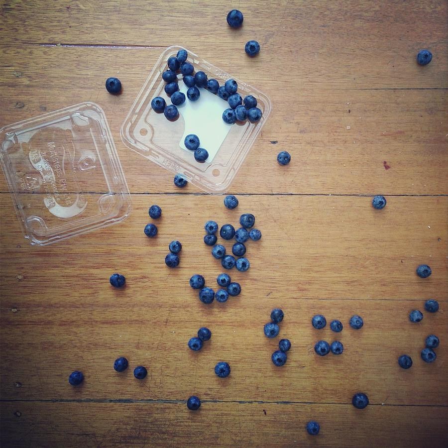 Punnet Of Blueberries Spilt On Wooden Photograph by Jodie Griggs