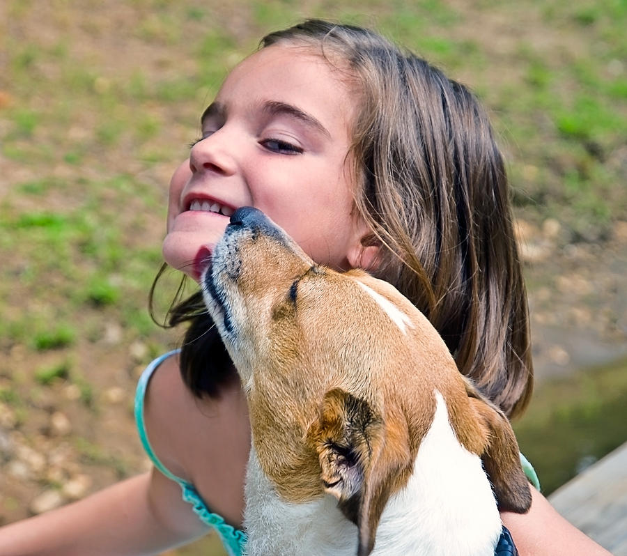 Child Photograph - Puppy Love by Susan Leggett