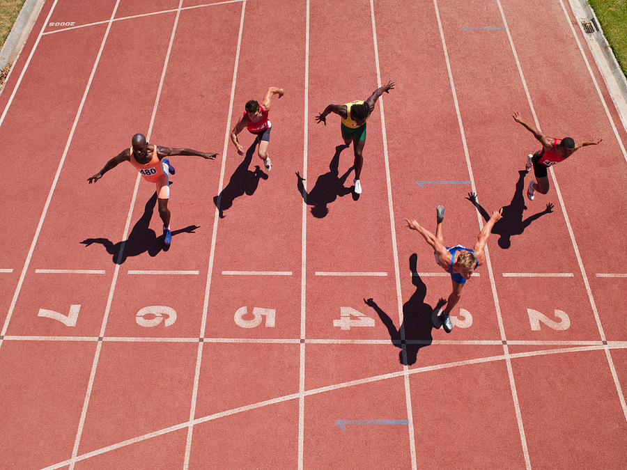 Racers at the start line on a track Photograph by Chris Ryan