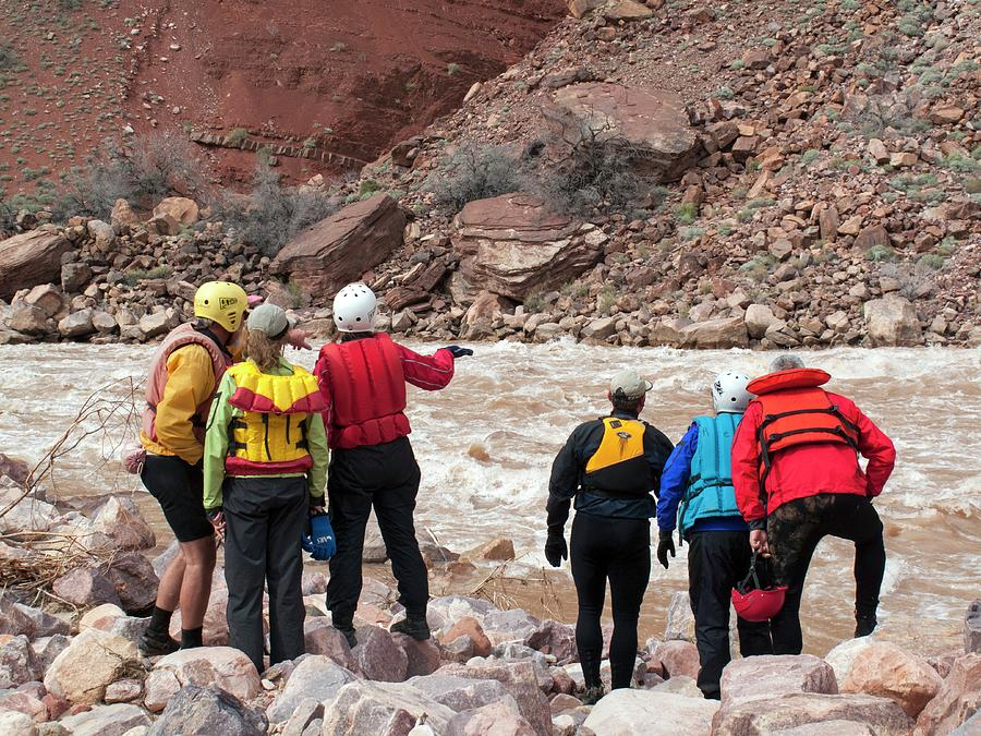Human Photograph - Rafters Scouting Rapids by Jim West