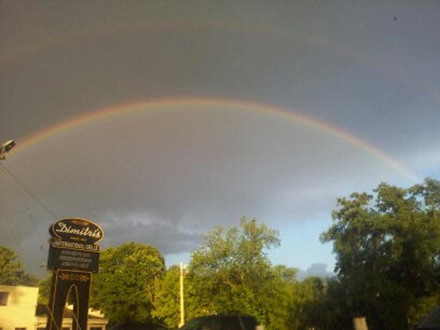Science Photograph - Rainbo And Alien Craft Point Of Entry Into Earth Atmosphere Shown In Upper Right Corner. by Marvin Harding