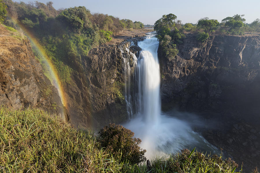 Rainbow In The Mist Of Victoria Falls Photograph by Vincent Grafhorst