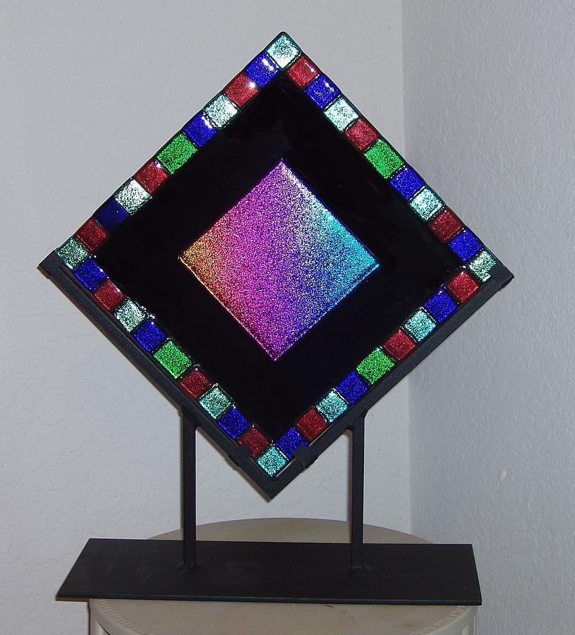 Dichroic Glass Is Fired On To A Black Art Glass Base Glass.  The Center Square Is Rainbow Dichroic Glass With Dichroic Squares Framing The Piece.  The Glass Measures 12 X 12 And Is Displayed In A Custom-made Wrought Iron Stand.  Price Includes The Stand. Glass Art - Rainbow by Judy Schnabel