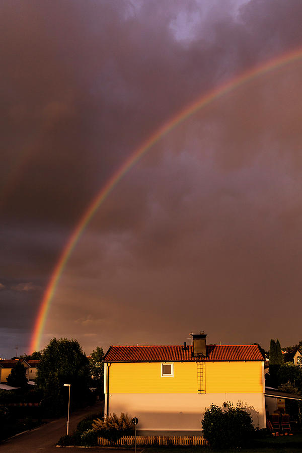 Rainbow Over Residential Structures Photograph by Katja Kircher