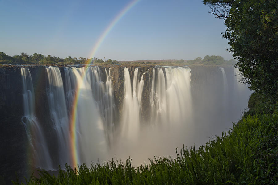 Rainbows In The Mist Of Victoria Falls Photograph by Vincent Grafhorst
