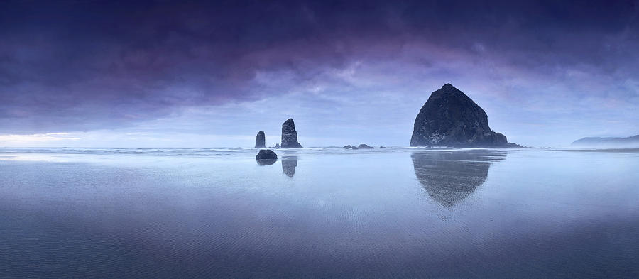 Cannon Beach Photograph - Rainy sunset over Cannon Beach by Sebastien Coursol