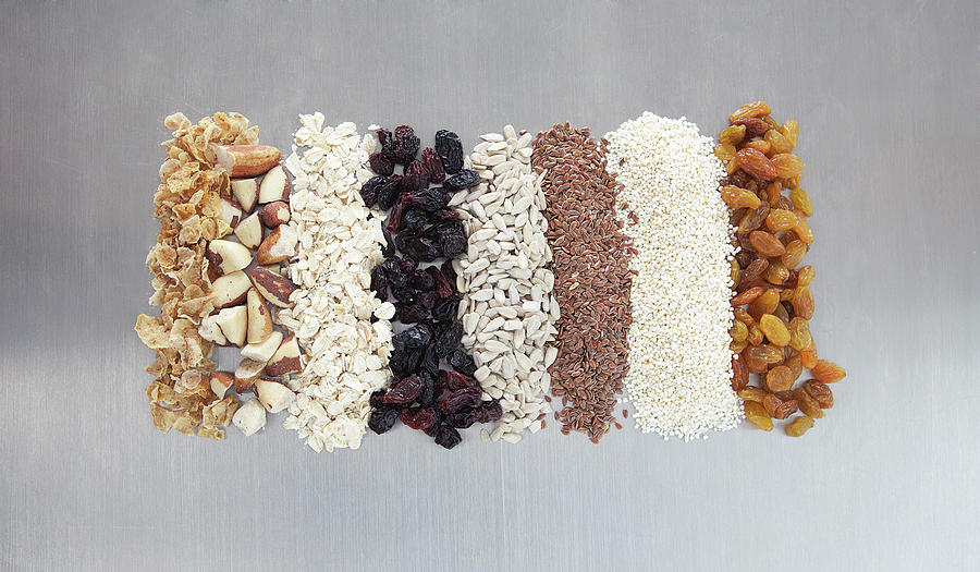 Raw Nuts, Dried Fruit And Grains Photograph by Laurie Castelli