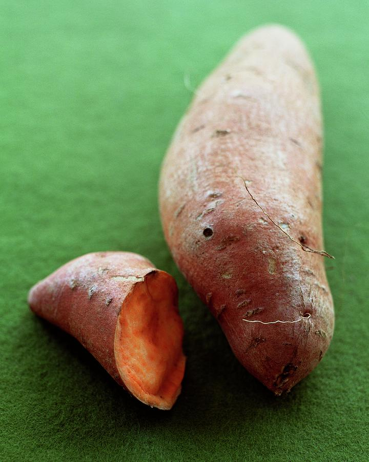 Raw Sweet Potatoes Photograph by Romulo Yanes