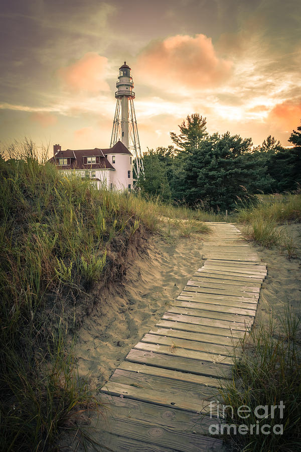 Rawley Point Lighthouse Photograph - Rawley Point Lighthouse Under Smoldering Skies by Ever-Curious Photography