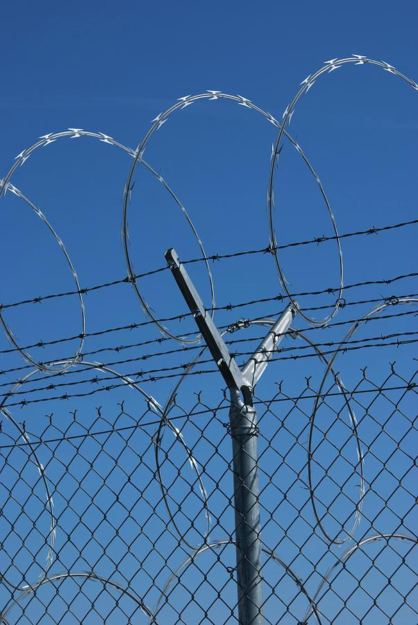 Razor Wire Fence In Las Vegas Photograph by Mark Williamson/science ...