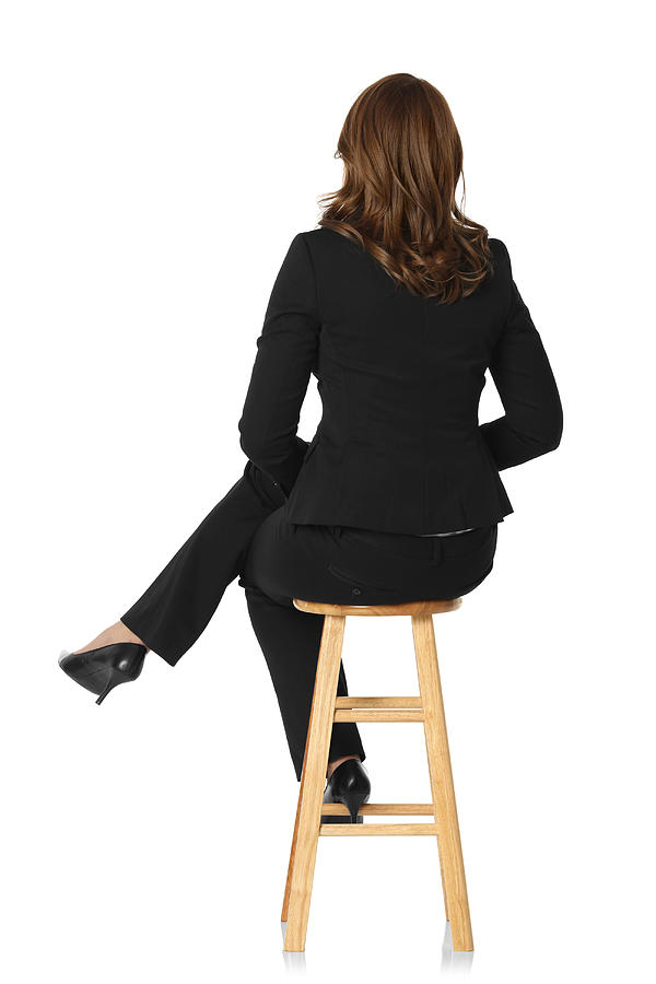 Rear View Of A Businesswoman Sitting On Stool Photograph by 4x6