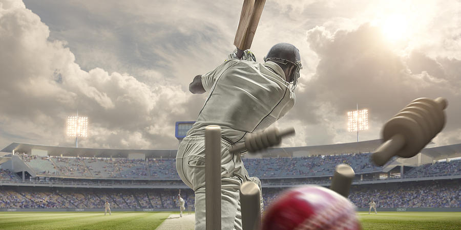 Rear View Of Cricket Ball Hitting Stumps Behind Batsman Photograph by Peepo